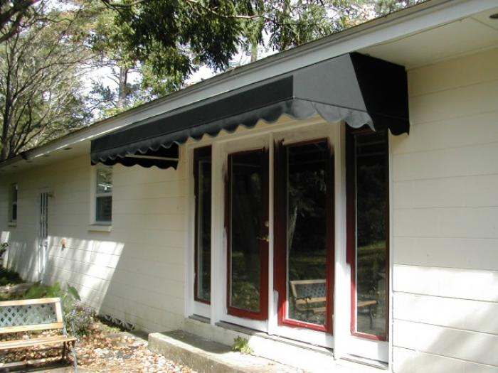 Marvelous Patio Style Covered In Sunbrella And Mounted Under The Eave Of The Roof.  This Keeps Water And Sun Off The Door And Out Of Your Home.